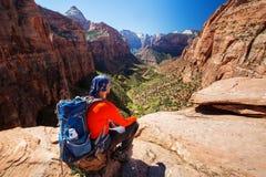 Men is hiking in Zion National Par, Utah, USA. A man is hiking in Zion National Par, Utah, USA Stock Photos