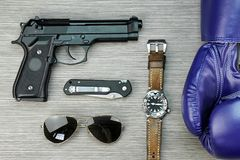 Men hobbies and collectibles, Boxing gloves, Watch, Gun. stock photo