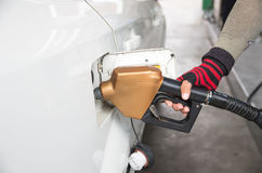 Men hold Fuel nozzle to add fuel in car at filling station Royalty Free Stock Photography