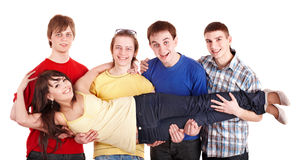 Men hold girl on hands. Stock Photos