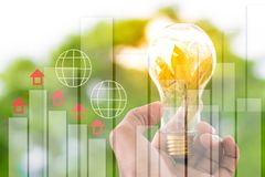 Men hold light bulbs with sun in the daytime, with bokeh backdrops and Statistic graph using wallpaper or background for idea work. For business work Royalty Free Stock Photo