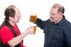 Men holding a beer belly and sausage. Elderly men holding a beer belly and sausage Royalty Free Stock Photography