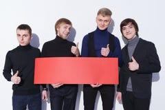 Men holding blank banner Stock Photo