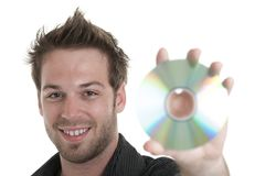 Men holding a cd or a dvd Royalty Free Stock Images
