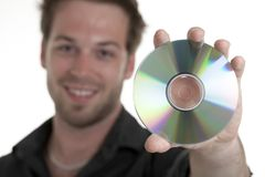 Men holding a cd or a dvd Stock Photos