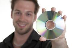 Men holding a cd or a dvd Stock Photos