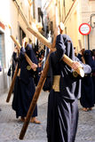 Men holding crucifix, Easter procession in Jerez Royalty Free Stock Photos