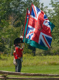 Men Holding Flags during Battle Reenactment Royalty Free Stock Photos