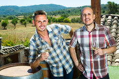 men holding glass with sparkling wine Stock Photo