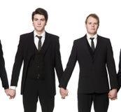 Men holding hands Stock Photo