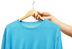 Men holding hanger with sweater Royalty Free Stock Photos