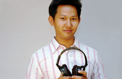 Men holding headphone Royalty Free Stock Images