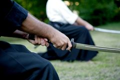 Men holding japanese swords. Outdoor Royalty Free Stock Photo