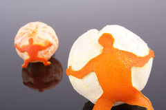 Men holding orange and mandarin Royalty Free Stock Photography