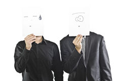 Men Holding Paper Face Masks Stock Photography