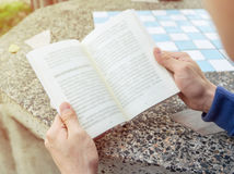 Men holding reading book Stock Images