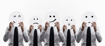 Men holding smilies Stock Images