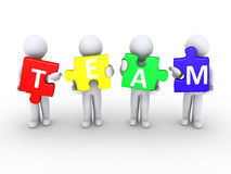Men holding team puzzle pieces. Four 3d persons holding puzzle pieces that form the word team Royalty Free Stock Photos