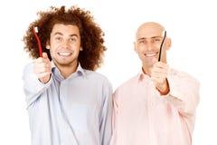Men holding toothbrushes stock image
