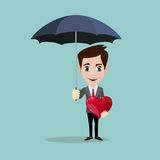 The men holds the open umbrella and the heart. The men holds Heart under umbrella, safety and insurance concept. isolated on background Stock Photo
