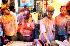 Men during Holi Festival. In the front of the shop in Udaipur Royalty Free Stock Photos