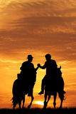 Men on horseback Royalty Free Stock Images