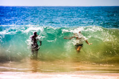 Men in huge big waves Royalty Free Stock Image