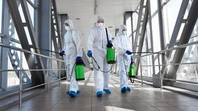 Free Men In A Protective Suit And Mask Disinfecting Tunnel With Gas Stock Photography - 178332812