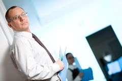 Men In Glasses With Tie And With Paper Royalty Free Stock Photography