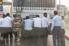 Men in India are pushing by a crowd the bus. Men in India are pushing the bus by a crowd Royalty Free Stock Photo