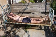 Men on iron bed stock photos