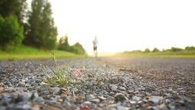 Men jogging in the evening for health. Men wear white jogging jogging in the evening for health stock footage