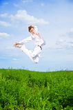 Men jump in the meadow Stock Photo