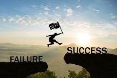 Men jump over silhouette hand hold flag best failure Committed. To success Stock Photos