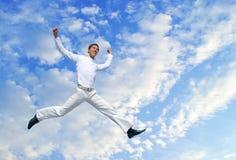 Men jumping against blue sky Stock Photos