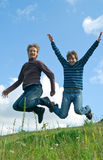 Men jumping against summer landscape Stock Images