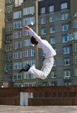 Men jumping against urban landscap Stock Images