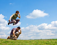 Men jumping one over another Stock Images