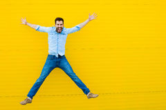 Men jumping on yellow background royalty free stock image
