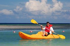 Men in the kayak. Men rowing in the yellow kayak Stock Photography