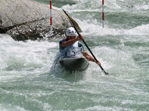 Men on a Kayak. Italian Championship of Canoe under 23 specialties slalom held in Piateda  in the river Adda Stock Photo