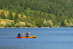 Men kayaking on bohinj lake Royalty Free Stock Photo