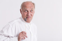 Men keeping the paper pipe in his mouth Royalty Free Stock Photography