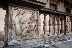 Men with the keys on the Renaissance style buildings Stock Images