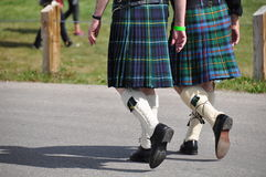 Men in kilts. Scottish Canadians gather in their traditional clan kilts at the Calgary Highland Games stock photography