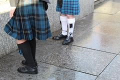 Men in Kilts. Bagpipers in Kilts, kilt hose and brogues in Edinburgh stock images