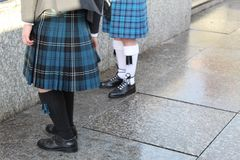 Men in Kilts. Bagpipers in Kilts, kilt hose and brogues in Edinburgh stock photography