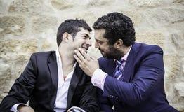 Men kissing Stock Image
