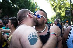Men kissing at the Gay Pride parade in Madrid Stock Image