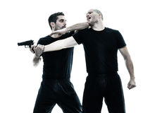 Men krav maga fighters fighting isolated Stock Photo